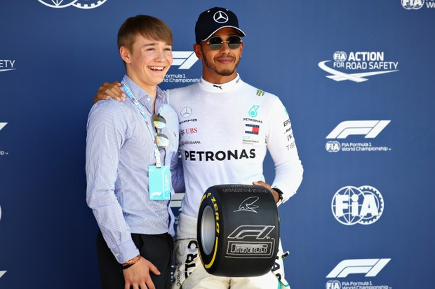 NORTHAMPTON, ENGLAND - JULY 07: Pole position qualifier Lewis Hamilton of Great Britain and Mercedes GP is presented with the Pirelli Pole Position trophy by Billy Monger during qualifying for the Formula One Grand Prix of Great Britain at Silverstone on July 7, 2018 in Northampton, England. (Photo by Mark Thompson/Getty Images)