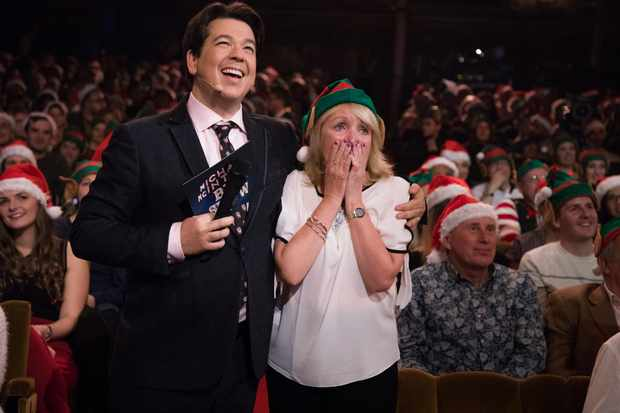 WARNING: Embargoed for publication until 00:00:01 on 11/12/2018 - Programme Name: Michael McIntyre's Big Christmas Show 2018 - TX: n/a - Episode: Michael McIntyre's Big Christmas Show - Episodics (No. n/a) - Picture Shows: Audience hit, Michelin Mum *STRICTLY NOT FOR PUBLICATION UNTIL 00:01HRS, TUESDAY 11TH DECEMBER, 2018* Michael McIntyre, Margaret - (C) Hungry McBear - Photographer: Gary Moyes