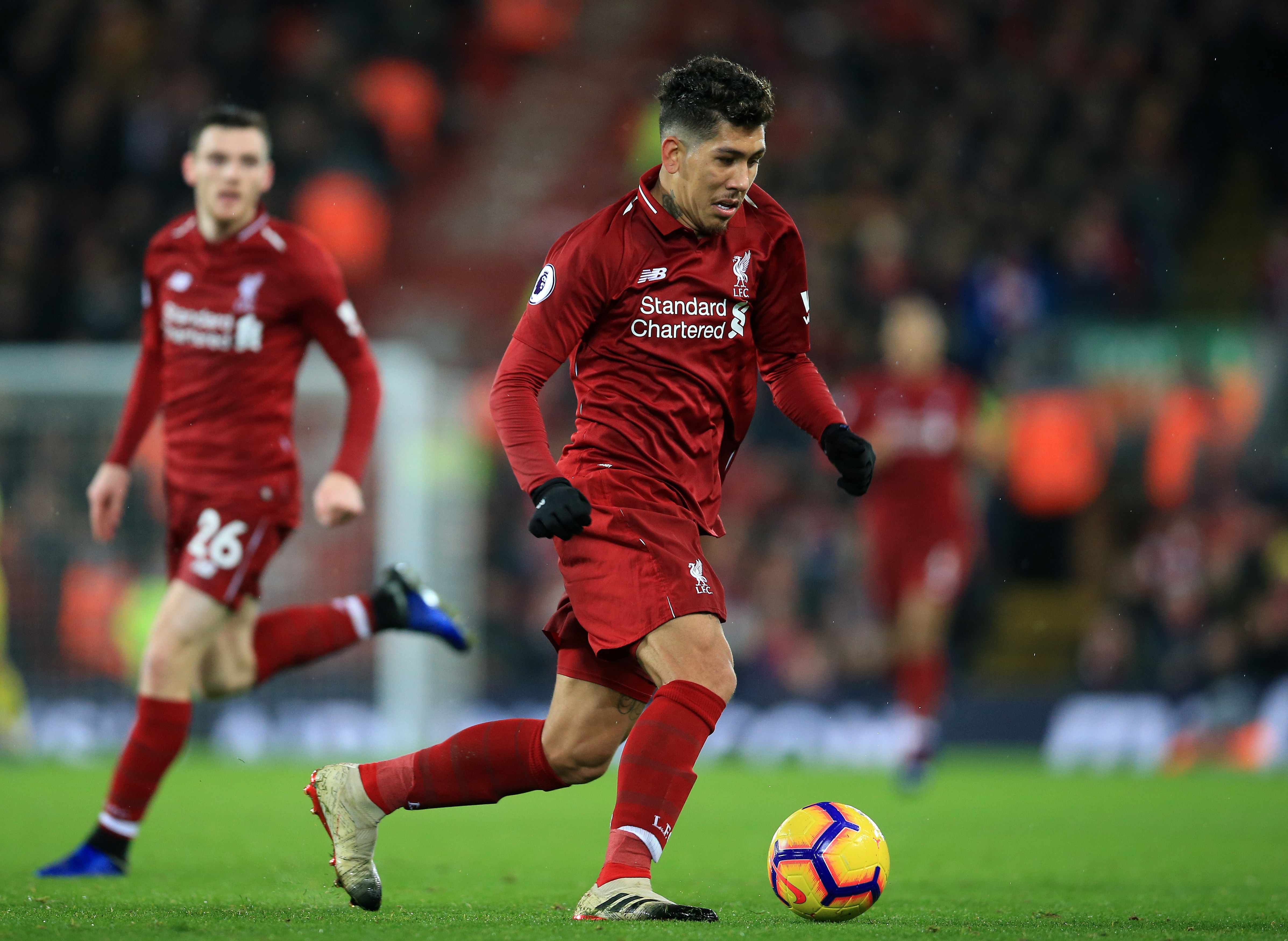 Roberto Firmino of Liverpool races forward on the ball (photo by David Blunsden/Action Plus via Getty Images)
