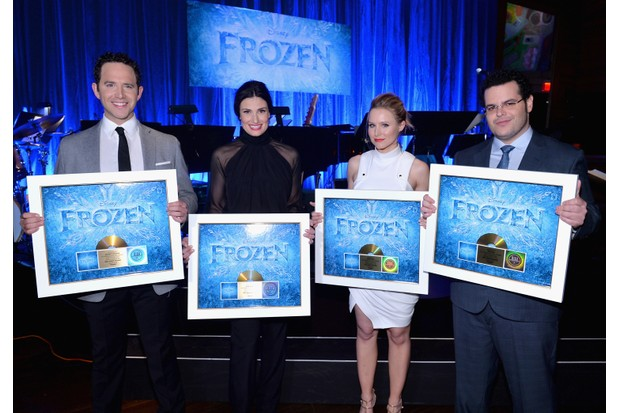 "LOS ANGELES, CA - FEBRUARY 09: The cast of Disney's ""Frozen"" were presented with gold records commemorating the success of the ""Frozen"" soundtrack. FOR THE FIRST TIME IN FOREVER, the music of Disney's ""Frozen"" was celebrated with live performances at Los Angeles Vibrato Grill Jazz club tonight. Kristen Bell (voice of Anna), Idina Menzel (voice of Elsa), Josh Gad (voice of Olaf) and Santino Fontana (voice of Hans) took the stage, accompanied by a live orchestra conducted by David Metzger, to perform songs from the Oscar®-nominated, Golden Globe®-winning film, including the Oscar-nominated ""Let It Go"" on February 9, 2014 in Los Angeles, California. (Photo by Alberto E. Rodriguez/Getty Images for Disney)"