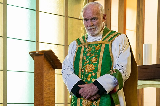 Ian McElhinney plays Father Timothy in Mrs Wilson