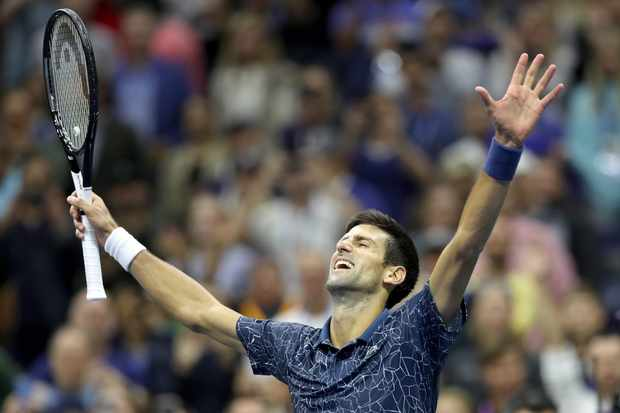 Novak Djokovic of Serbia celebrates his win over Juan Martin Del Potro of Argentina during the men's final of the US Open at Arthur Ashe Stadium on September 9, 2018 in New York City.  (Photo by Matthew Stockman/Getty Images)
