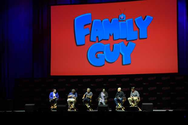 Andy Swift, Alec Sulkin, John Viener, Kara Vallow, Richard Appel, Mike Henry and John Viener speak onstage at the Family Guy panel during 2018 New York Comic Con (Getty)