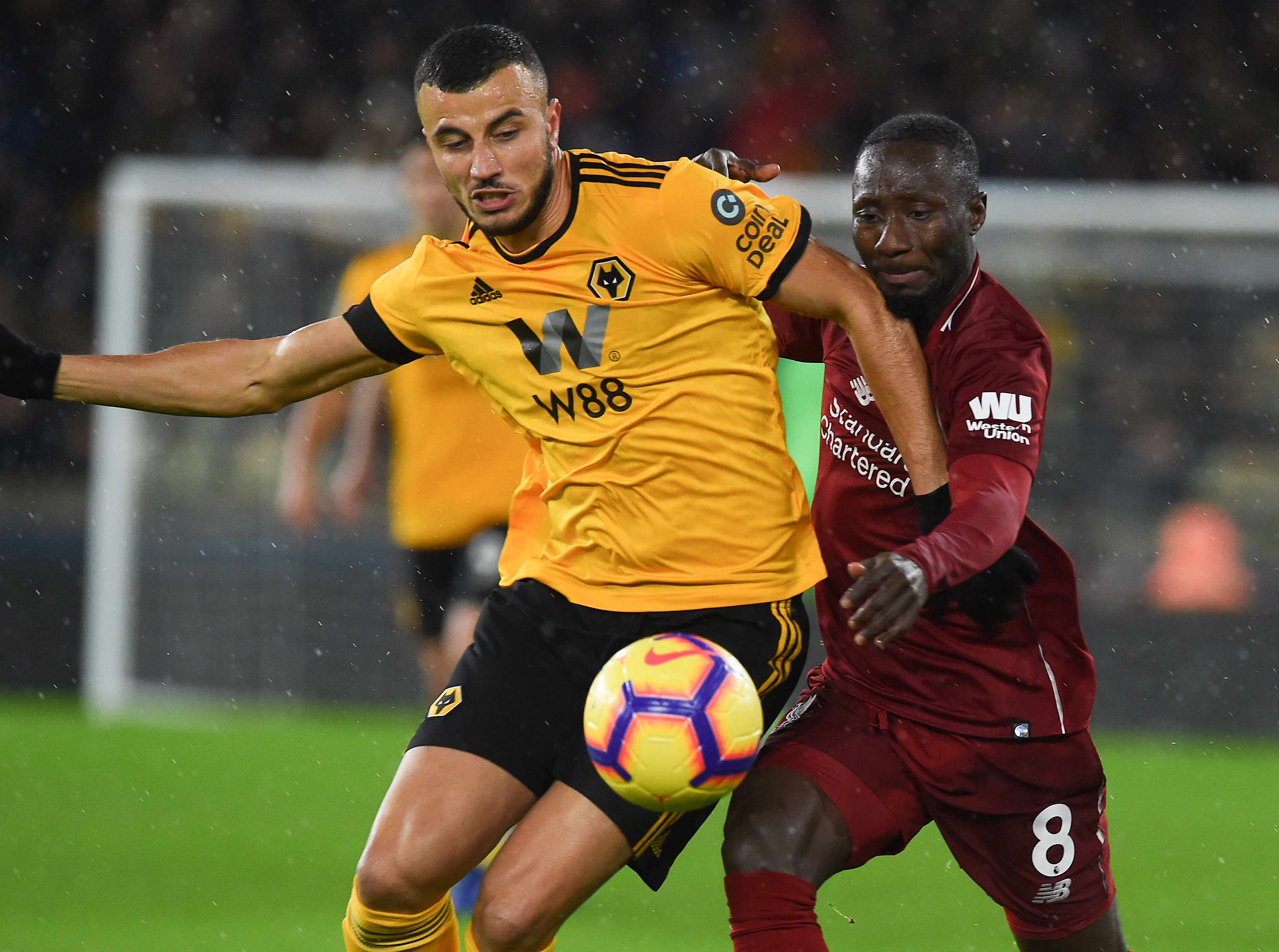 WOLVERHAMPTON, ENGLAND - DECEMBER 21: (THE SUN OUT,THE SUN ON SUNDAY OUT) Nabi Keita of Liverpool battles with Romain Saiss of Wolves during the Premier League match between Wolverhampton Wanderers and Liverpool FC at Molineux on December 22, 2018 in Wolverhampton, United Kingdom. (Photo by Nick Taylor //Liverpool FC via Getty Images)
