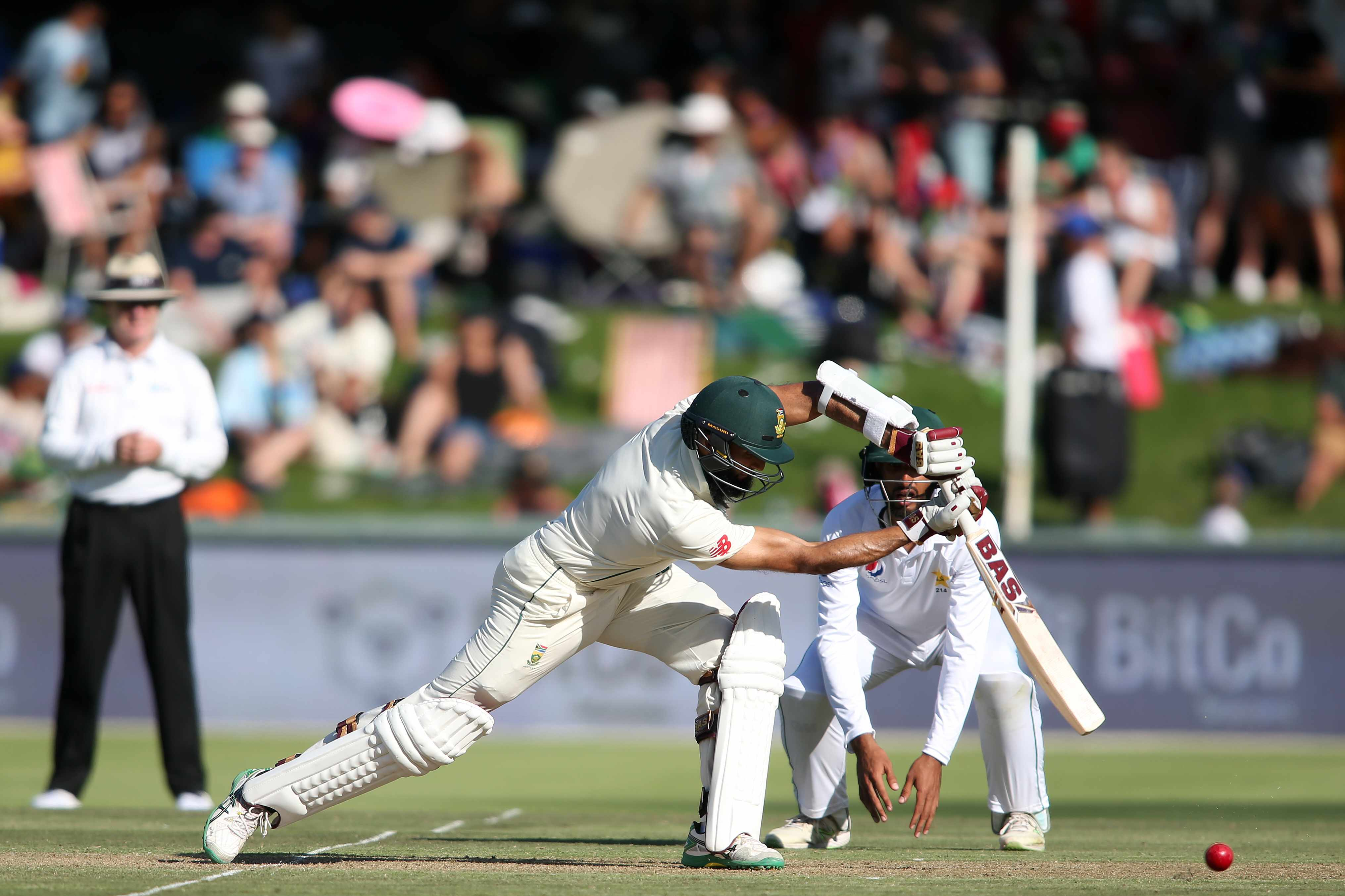 CAPE TOWN, SOUTH AFRICA - JANUARY 03: Hashim Amla of South Africa drives a delivery during day 1 of the 2nd Castle Lager Test match between South Africa and Pakistan at PPC Newlands on January 03, 2019 in Cape Town, South Africa. (Photo by Shaun Roy/Gallo Images/ Getty Images)