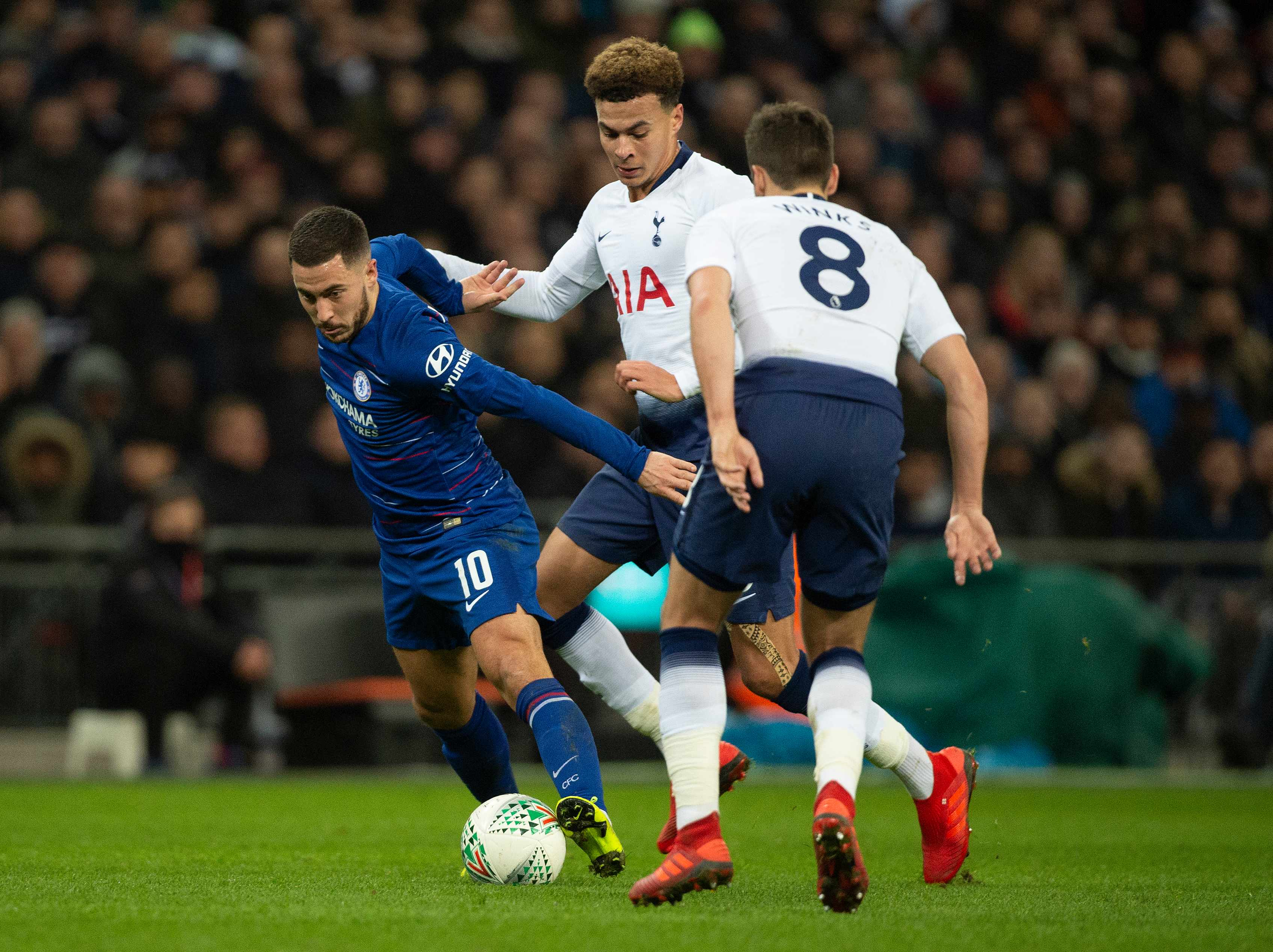 LONDON, ENGLAND - JANUARY 08: Dele Alli and Harry Winks of Tottenham Hotspur and Eden Hazard of Chelsea during the Carabao Cup Semi-Final between Tottenham Hotspur and Chelsea at Wembley Stadium on January 8, 2019 in London, England. (Photo by Visionhaus/Getty Images)