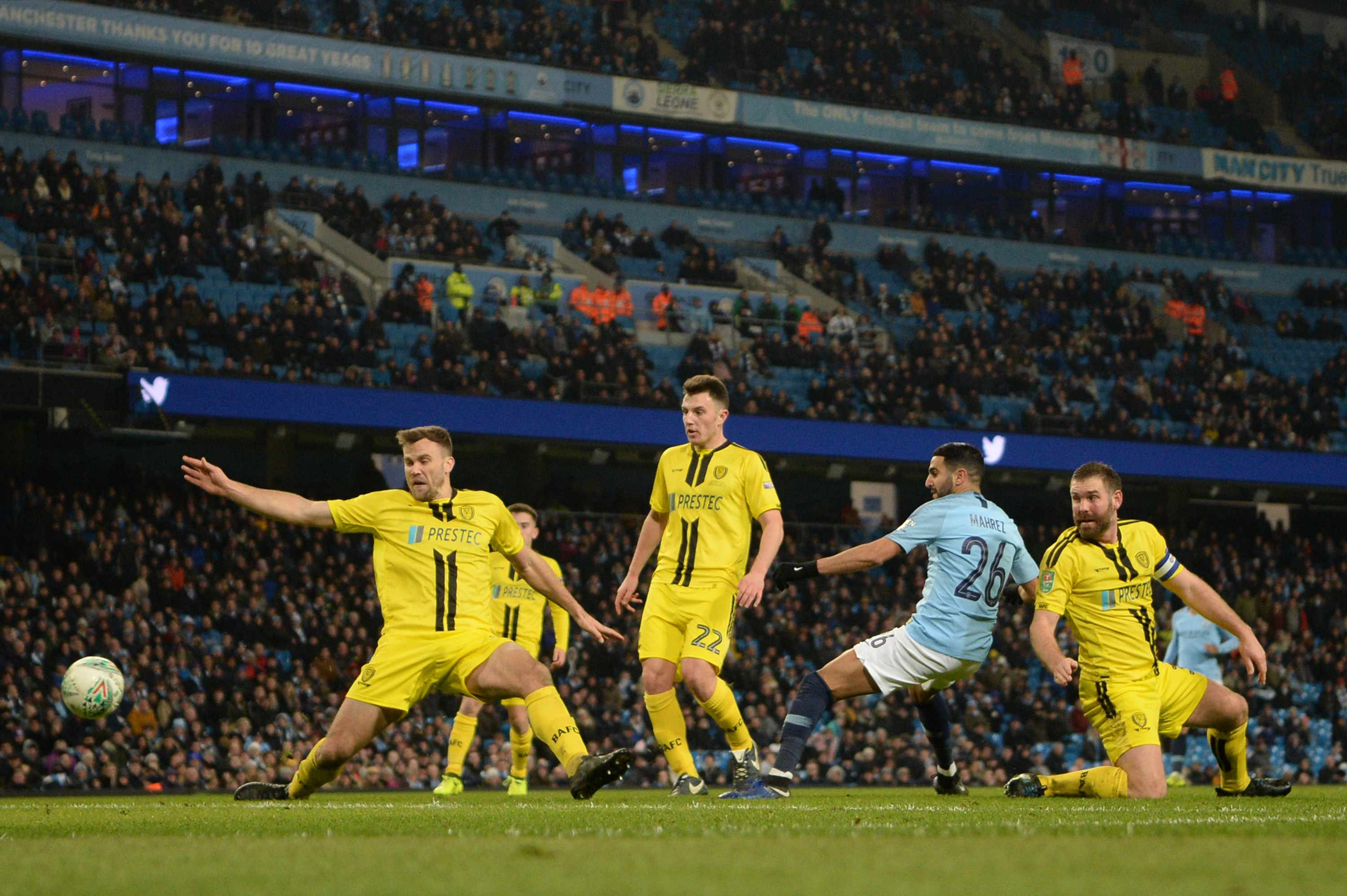 MANCHESTER, ENGLAND - JANUARY 09: (EDITORS NOTE: Recrop of image number 1079814908)  Riyad Mahrez of Manchester City scores his team's ninth goal during the Carabao Cup Semi Final First Leg match between Manchester City and Burton Albion at Etihad Stadium on January 9, 2019 in Manchester, United Kingdom. (Photo by Michael Regan/Getty Images)