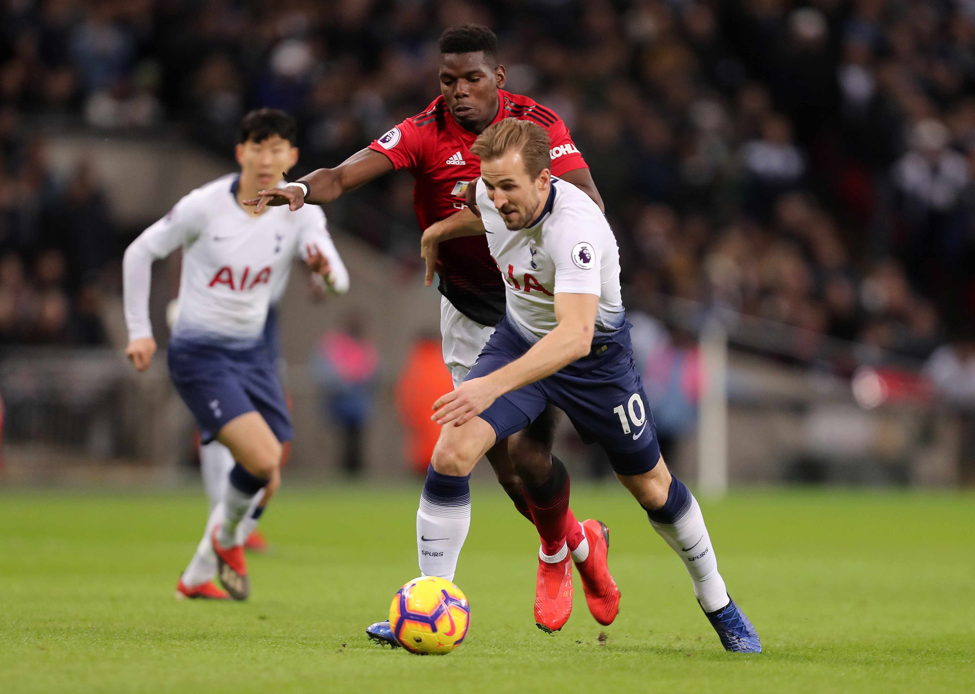 LONDON, ENGLAND - JANUARY 13: Harry Kane of Tottenham Hotspur is challenged by Paul Pogba of Manchester United during the Premier League match between Tottenham Hotspur and Manchester United at Wembley Stadium on January 13, 2019 in London, United Kingdom. (Photo by Tottenham Hotspur FC/Tottenham Hotspur FC via Getty Images)