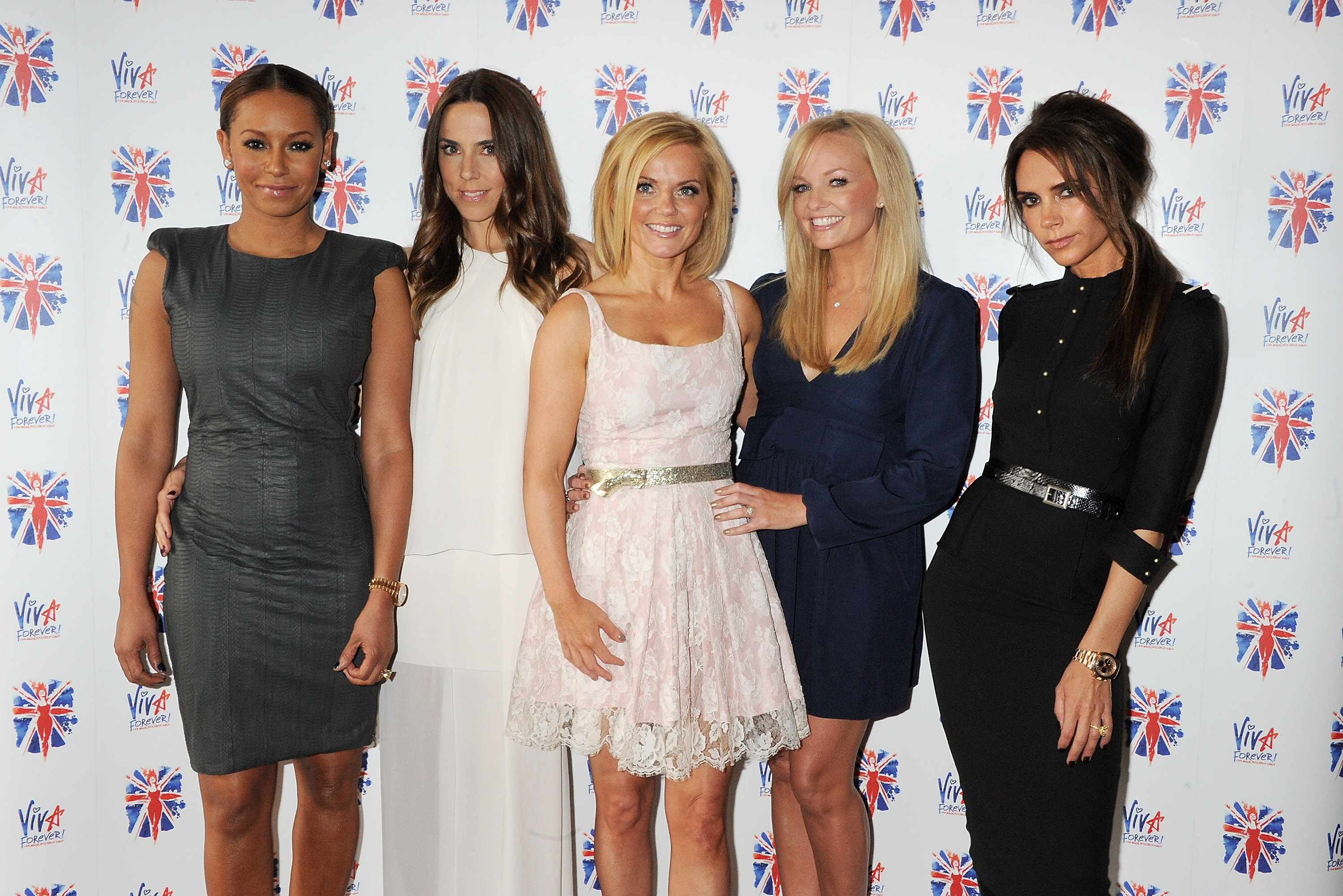 LONDON, ENGLAND - JUNE 26:  (EMBARGOED FOR PUBLICATION IN UK TABLOID NEWSPAPERS UNTIL 48 HOURS AFTER CREATE DATE AND TIME. MANDATORY CREDIT PHOTO BY DAVE M. BENETT/GETTY IMAGES REQUIRED)  (L to R) Melanie Brown aka Mel B, Melanie Chisholm aka Mel C, Geri Halliwell, Emma Bunton and Victoria Beckham pose at the press launch of 'Viva Forever', a new musical based on the music of The Spice Girls, at the St Pancras Renaissance Hotel on June 26, 2012 in London, England.  (Photo by Dave M. Benett/Getty Images)