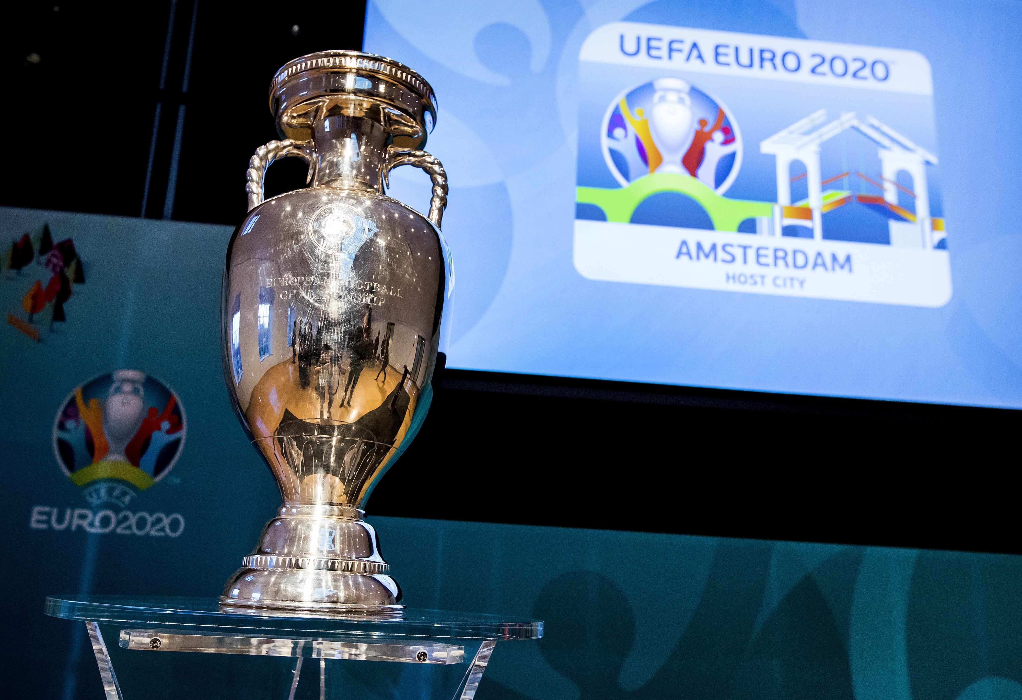 A picture taken on December 16, 2016 shows the EURO 2020 UEFA European Championship trophy during the launch of the Amsterdam's logo for the EURO 2020 UEFA European Championship football tournament in Amsterdam. The EURO 2020 UEFA European Championship will be held in thirteen cities in thirteen different European countries during the summer of 2020, with the semi-finals and final staged at Wembley stadium in London on July 2020. / AFP / ANP / Koen van Weel / Netherlands OUT        (Photo credit should read KOEN VAN WEEL/AFP/Getty Images)