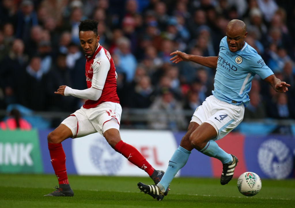 Arsenal's Pierre-Emerick Aubameyang and Manchester City's Vincent Kompany during Carabao Cup Final match between Arsenal against Manchester City at Wembley stadium, London  England on 25 Feb 2018	 (Photo by Kieran Galvin/NurPhoto via Getty Images)