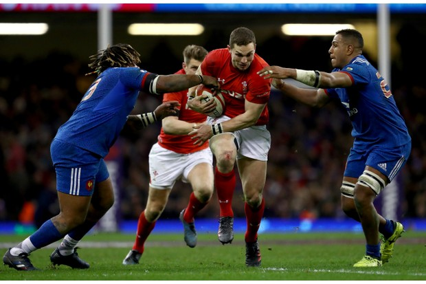 CARDIFF, WALES - MARCH 17: George North of Wales is tackled by Mathieu Bastareaud of France and Mathieu Babillot of France during the NatWest Six Nations match between Wales and France at Principality Stadium on March 17, 2018 in Cardiff, Wales. (Photo by Michael Steele/Getty Images)