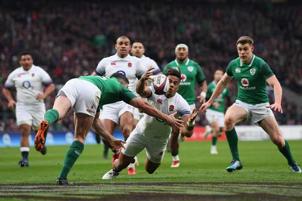 LONDON, ENGLAND - MARCH 17:  Anthony Watson of England fumbles the ball while later leads to Ireland scoring a try during NatWest Six Nations match between England and Ireland at Twickenham Stadium on March 17, 2018 in London, England.  (Photo by Shaun Botterill/Getty Images)