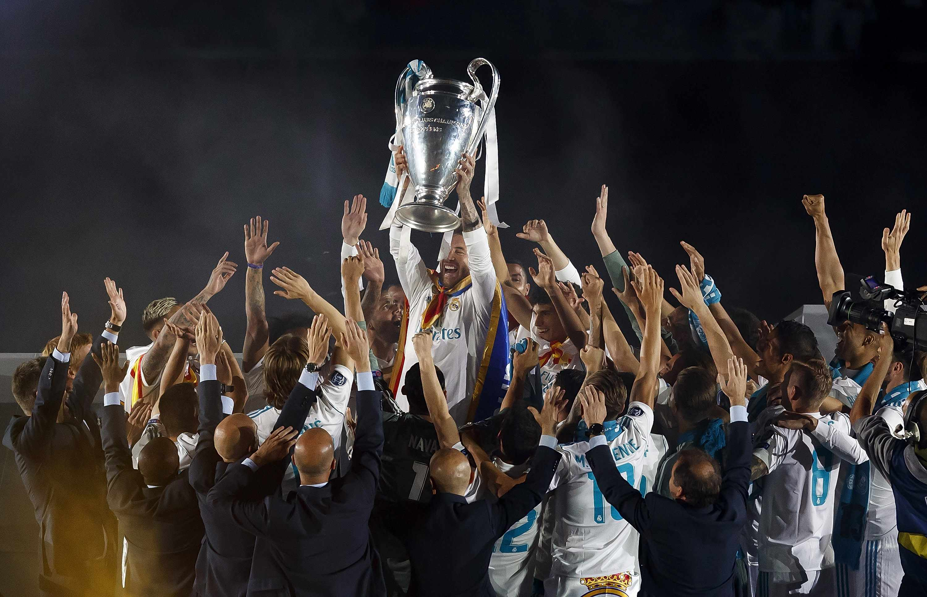 MADRID, SPAIN - MAY 27:  Captain Sergio Ramos of Real Madrid holds up the Champions League trophy with his teammates as they celebrate at Estadio Santiago Bernabeu a day after winning their 13th European Cup and UEFA Champions League Final on May 27, 2018 in Madrid, Spain.  (Photo by Angel Martinez/Real Madrid via Getty Images)