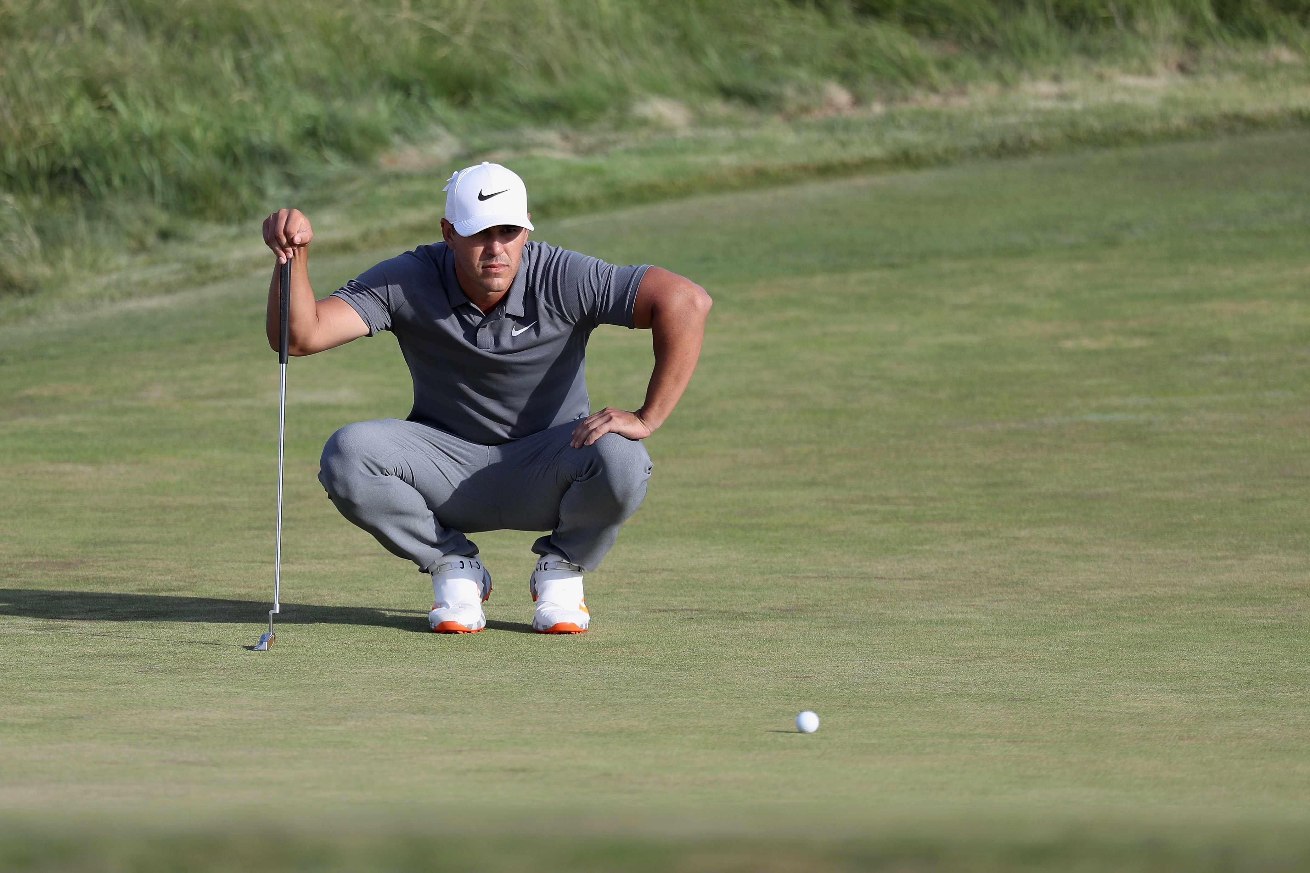 SOUTHAMPTON, NY - JUNE 17: Brooks Koepka of the United States putts on the 18th green during the final round of the 2018 U.S. Open at Shinnecock Hills Golf Club on June 17, 2018 in Southampton, New York.  (Photo by Rob Carr/Getty Images)