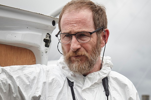 Paul Kaye plays Malcolm Donahue in Vera
