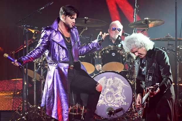 "LAS VEGAS, NV - SEPTEMBER 01:  (L-R) Singer Adam Lambert, drummer Roger Taylor and guitarist Brian May of Queen + Adam Lambert perform as the group kicks off its 10-date limited engagement, ""The Crown Jewels,"" at Park Theater at Park MGM on September 1, 2018 in Las Vegas, Nevada.  (Photo by Ethan Miller/Getty Images)"
