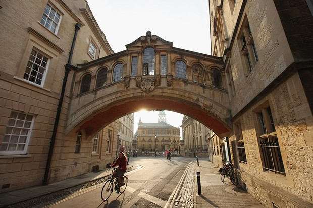 A woman cycles under the Bridge of Sighs along New College Lane on March 22, 2012 in Oxford, England.