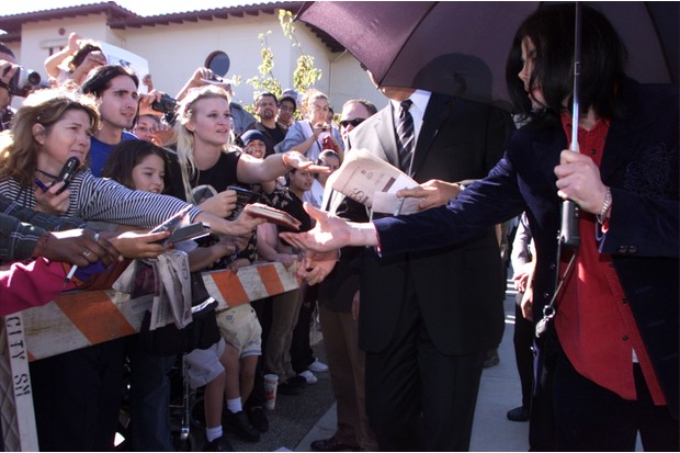 Michael Jackson signs autographs for fans