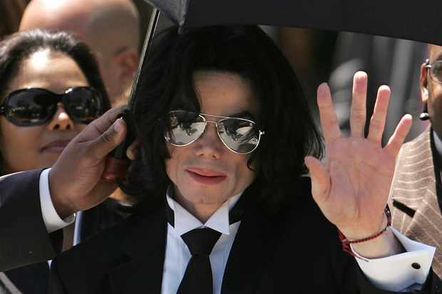 Michael Jackson waves to fans after he is found not guilty at his 2005 trial (Getty)