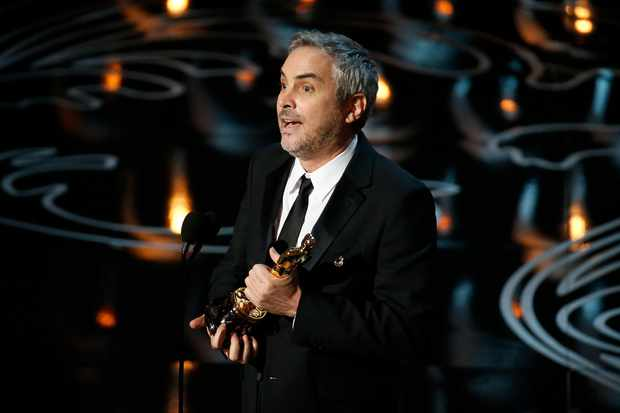 Alfonso Cuaron at the 2014 Oscars (Getty)