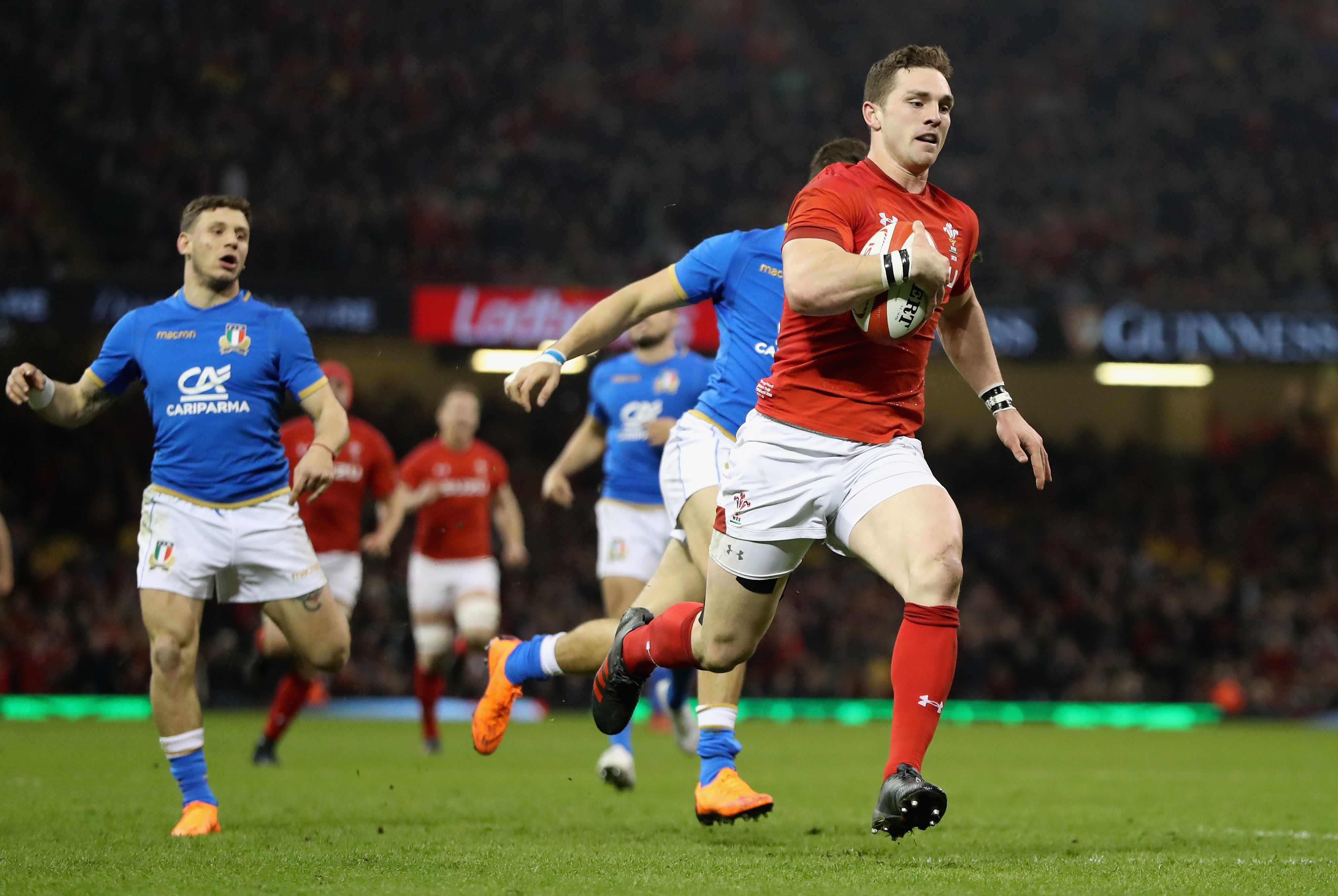 CARDIFF, WALES - MARCH 11:  George North of Wales breaks through to score his first try during the NatWest Six Nations match between Wales and Italy at the Principality Stadium on March 11, 2018 in Cardiff, Wales.  (Photo by David Rogers/Getty Images)
