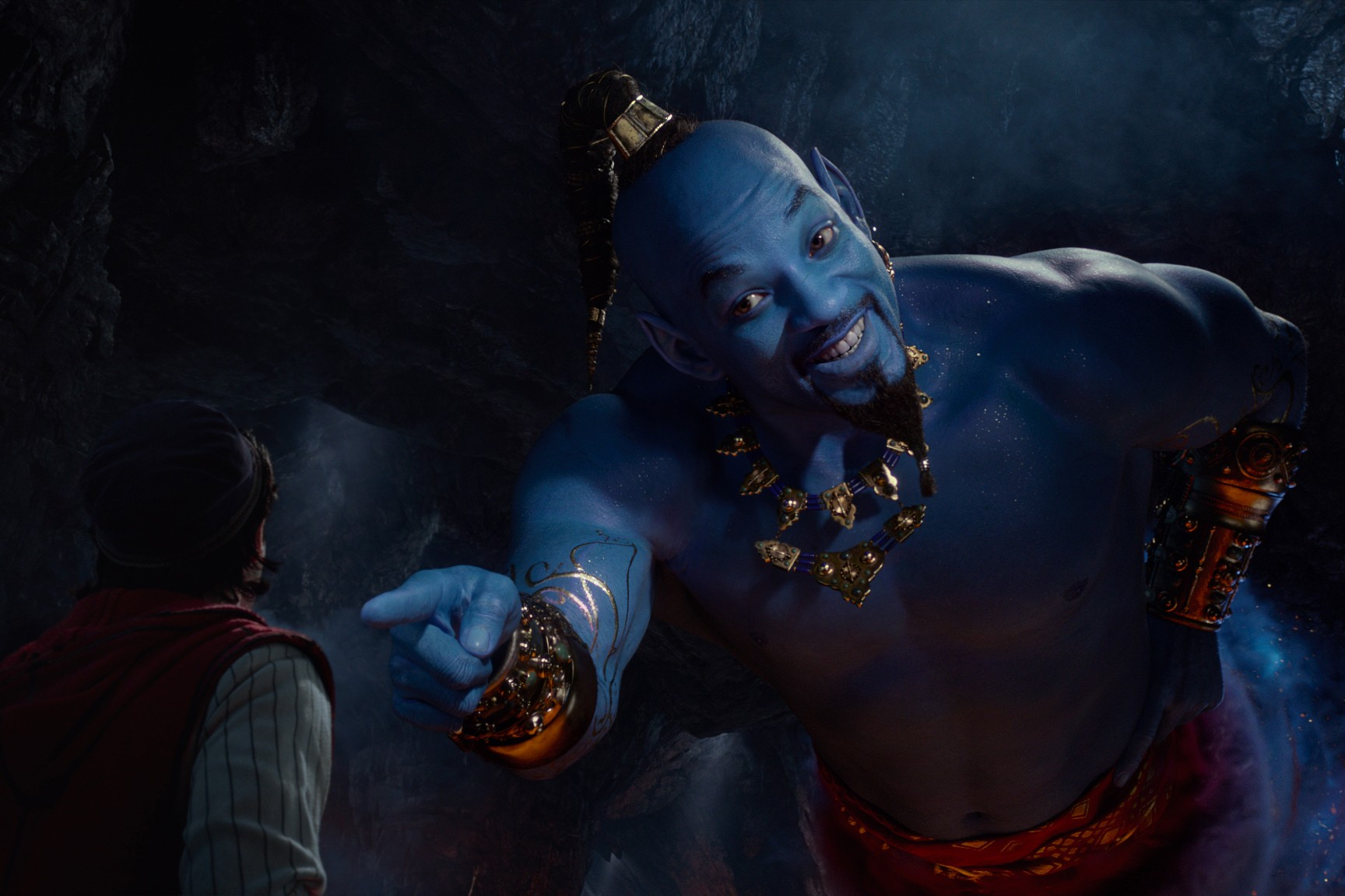 Aladdin (Mena Massoud) meets the blue Genie (Will Smith) in Disney's live-action adaptation of Aladdin, directed by Guy Ritchie (Disney)