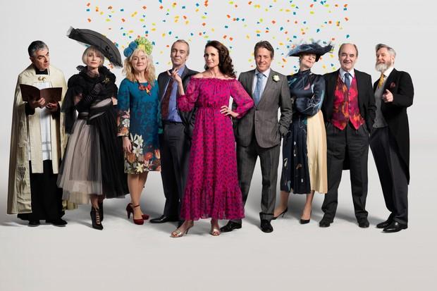 Father Gerald (ROWAN ATKINSON), Fiona (KRISTIN SCOTT THOMAS), Lydia (SOPHIE THOMPSON), Matthew (JOHN HANNAH), Carrie (ANDIE MACDOWELL), Charles (HUGH GRANT), Henrietta (ANNA CHANCELLOR), Bernard (DAVID HAIG), Tom (JAMES FLEET) in One Red Nose Day and a Wedding (BBC)