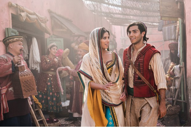 Naomi Scott as Jasmine and Mena Massoud as Aladdin in Disney's live-action adaptation of Aladdin, directed by Guy Ritchie (Disney)