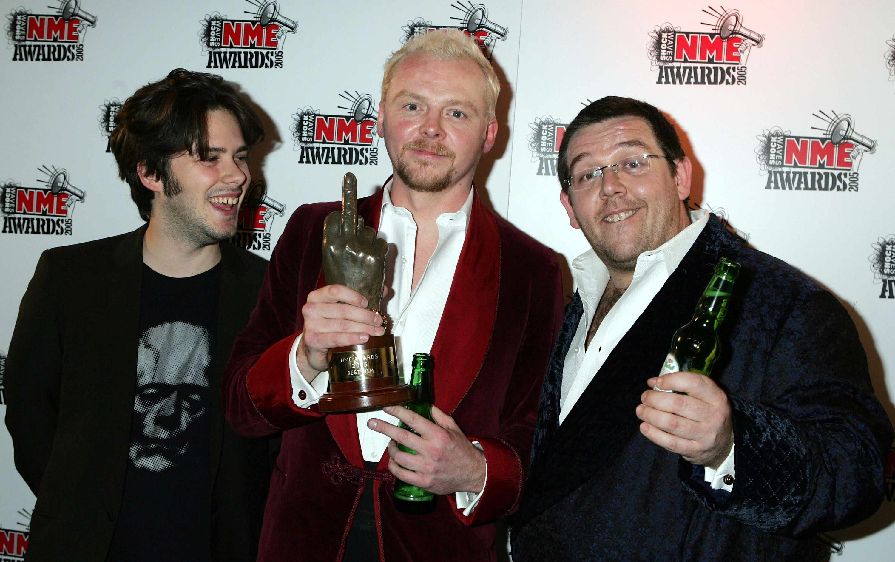 LONDON - FEBRUARY 17:  Simon Pegg (C) from the film Shaun Of The Dead poses in the Awards Room with the award for Best Film at The Shockwaves NME Awards 2005 at Hammersmith Palais on February 17, 2005 in London. The annual music awards sees winners decided by an NME readers' poll. (Photo by Jo Hale/Getty Images)