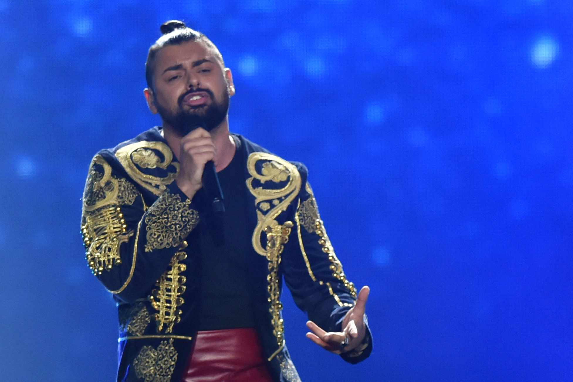 """Hungarian singer, rapper and guitarist, representing Hungary with the song """"Origo"""" Papai Jozsef aka Papai Joci performs on stage during the final of the 62nd edition of the Eurovision Song Contest 2017 Grand Final at the International Exhibition Centre in Kiev, on May 13, 2017. / AFP PHOTO / SERGEI SUPINSKY        (Photo credit should read SERGEI SUPINSKY/AFP/Getty Images)"""