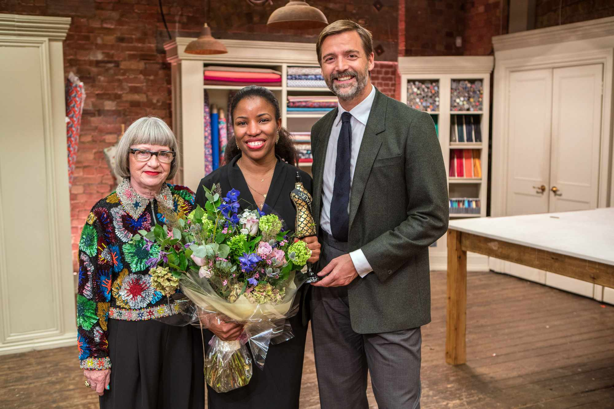 Programme Name: The Great British Sewing Bee - TX: 02/04/2019 - Episode: The Winner (No. The Winner) - Picture Shows: **STRICTLY EMBARGOED UNTIL 22:01 HRS ON TUESDAY 2ND APRIL** Esme Young, Juliet, Patrick Grant - (C) Love Productions - Photographer: Mark Bourdillon