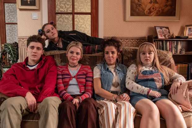 Derry Girls cast, l-r:  Dylan (James Maguire), Erin (Saoirse Monica-Jackson), Michelle (Jamie-Lee O'Donnell),  Clare (Nicola Coughlan). Above:  Orla McCool (Louisa Clare Harland)