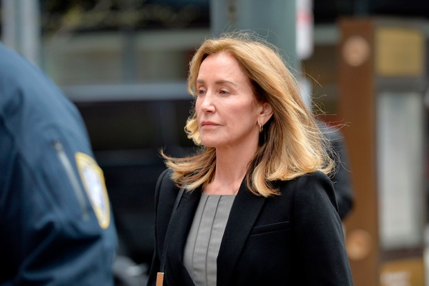 Actress Felicity Huffman is escorted by Police into court where she is expected to plead guilty to one count of conspiracy to commit mail fraud and honest services mail fraud before Judge Talwani at John Joseph Moakley United States Courthouse in Boston, Massachusetts, May 13, 2019. (Photo by Joseph Prezioso / AFP) (Photo credit should read JOSEPH PREZIOSO/AFP/Getty Images)