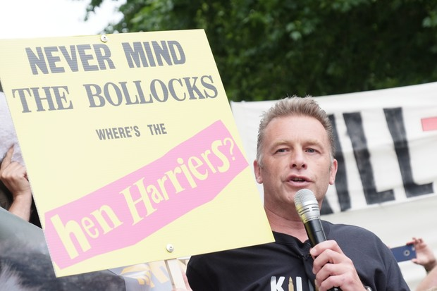 Chris Packham with signs during a protest though central London (Getty Images)