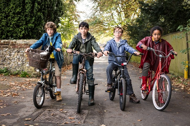Sam Taylor Buck as Adam Young, the reluctant Antichrist;Ilan Galkoff as Brian; Alfie Taylor as Wensleydale; Amma Ris as Pepper, in Good Omens