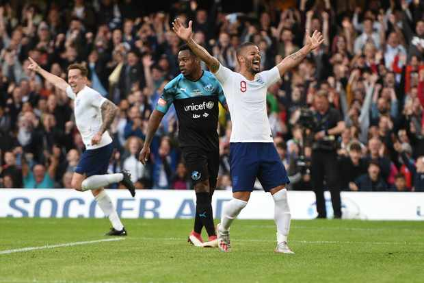 Jeremy Lynch of England celebrates after scoring the opening goal during action from the Soccer Aid for Unicef match at Stamford Bridge, London, 16 Jun 2019.