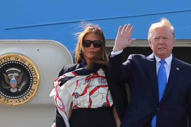 US President Donald Trump (R) and US First Lady Melania Trump (L) disembark Air Force One at Stansted Airport, north of London on June 3, 2018, as they begin a three-day State Visit to the UK. - Britain rolled out the red carpet for US President Donald Trump on June 3 as he arrived in Britain for a state visit already overshadowed by his outspoken remarks on Brexit. (Photo by Isabel Infantes / AFP)        (Photo credit should read ISABEL INFANTES/AFP/Getty Images)