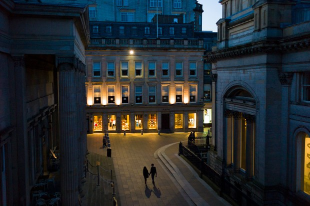 Couple in Royal Exchange Square in the City Centre, Glasgow