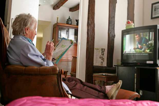 Senior woman watching Television. (Photo by: Media for Medical/Universal Images Group via Getty Images)