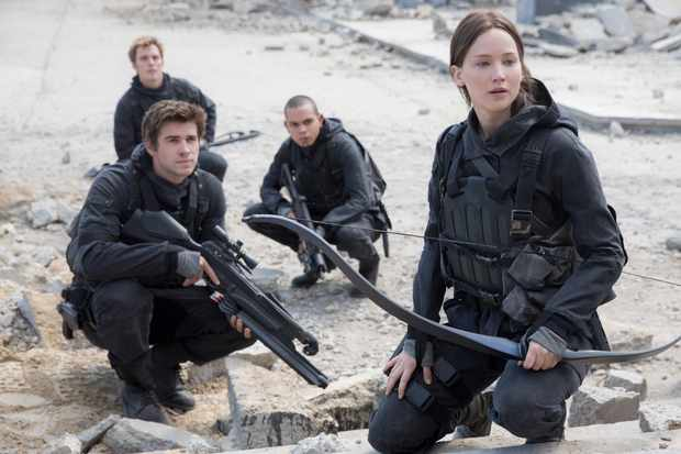Jennifer Lawrence as Katniss Everdeen, Liam Hemsworth as Gale Hawthorne