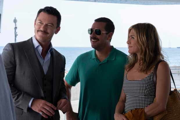 Luke Evans as Charles Cavendish, Adam Sandler as Nick Spitz and Jennifer Aniston as Audrey Spitz in MURDER MYSTERY