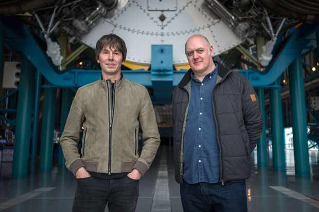 Professor Brian Cox, Dara Ó Briain in front of a Saturn V rocket, Kennedy Space Center, Florida.
