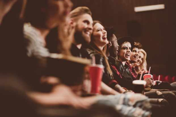 Group of people in the cinema having fun