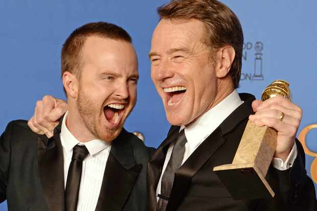 """Actors Aaron Paul (L) and Bryan Cranston (R), pose in the press room after Cranston won Best Actor in a TV drama and """"Breaking Bad"""" won Best Series - Drama, at the 71st Annual Golden Globe Awards in Beverly Hills, California, January 12, 2014. AFP PHOTO / ROBYN BECK (Photo credit should read ROBYN BECK/AFP/Getty Images)"""