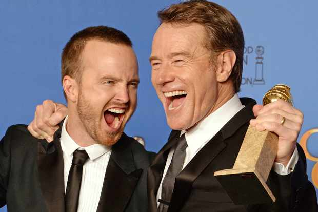 "Actors Aaron Paul (L) and Bryan Cranston (R), pose in the press room after Cranston won Best Actor in a TV drama and ""Breaking Bad"" won Best Series - Drama, at the 71st Annual Golden Globe Awards in Beverly Hills, California, January 12, 2014."