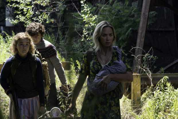 """L-r, Regan (Millicent Simmonds), Marcus (Noah Jupe) and Evelyn (Emily Blunt) brave the unknown in A Quiet Place Part II."""