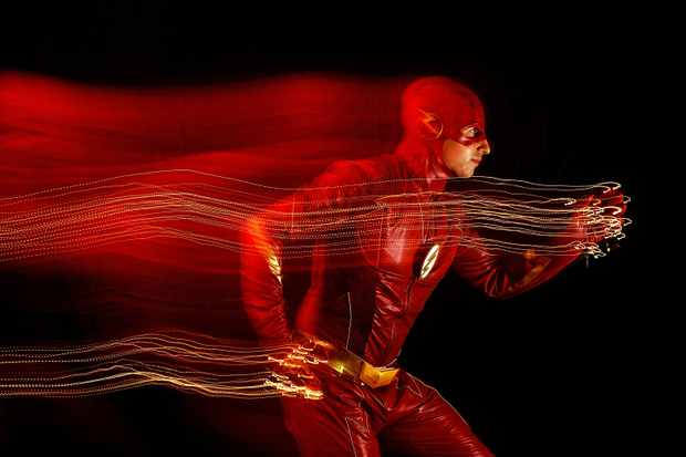 NEW YORK, NY - OCTOBER 06: (EDITORS NOTE: Exposure effect made in camera to produce this image.)  A cosplayer poses as The Flash during New York Comic Con 2018 at Javits Center on October 6, 2018 in New York City.  (Photo by Mike Coppola/Getty Images)