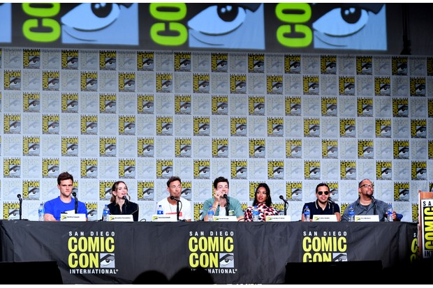 """SAN DIEGO, CALIFORNIA - JULY 20: (L-R) Hartley Sawyer, Danielle Panabaker, Tom Cavanagh, Grant Gustin, Candice Patton, Carlos Valdes, and Eric Wallace speak at """"The Flash"""" Special Video Presentation and Q&A during 2019 Comic-Con International at San Diego Convention Center on July 20, 2019 in San Diego, California. (Photo by Amy Sussman/Getty Images)"""