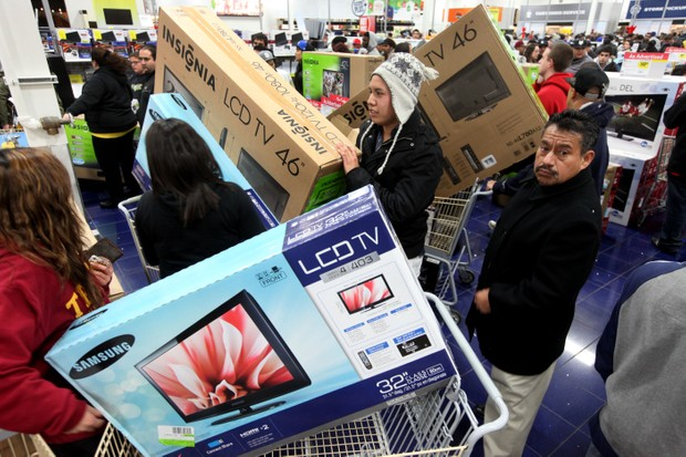 SAN DIEGO, CA - NOVEMBER 25: Customers shop for electronics items during 'Black Friday' at a Best Buy store on November 25, 2011 San Diego, California. Thousands of consumers are queuing at various stores across the nation to take advantage of 'Black Friday' deals as the holiday shopping season begins in America. (Photo by Sandy Huffaker/Getty Images)